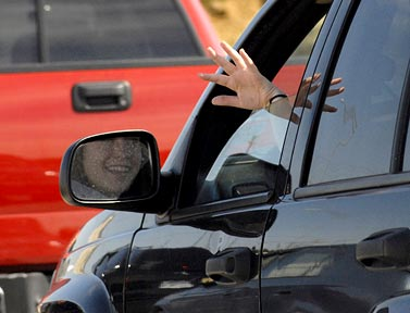 hand-waving-from-car